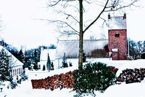 Idyllic village with snow covered church